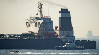 A Royal Marine patrol vessel is seen beside the Grace 1 super tanker in the British territory of Gibraltar.
