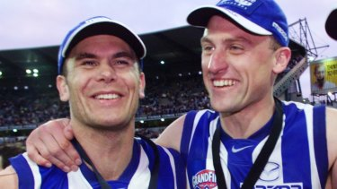Former Kangaroos teammates Wayne Carey (left) and John Longmire.
