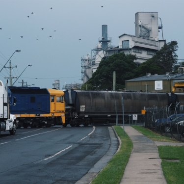 A freight train departs the Manildra mill in Bomaderry, one of the largest employers in the area.