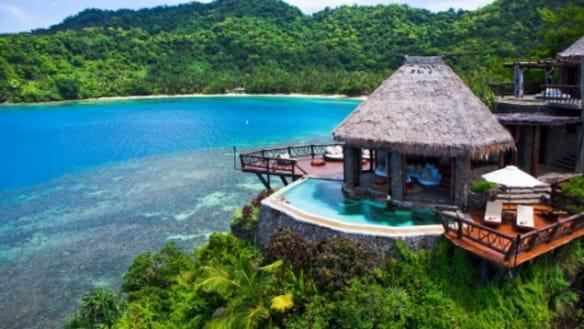 Big bank boss in investigation over resort holiday