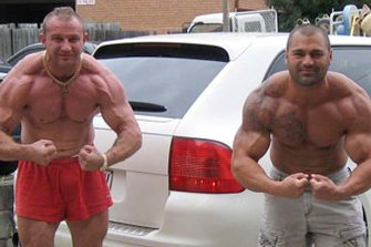 Convicted cocaine trafficker, dock worker and professional bodybuilder, Adam Powell, left, with Hakan Ayik.