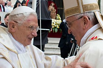 The real Pope Benedict, left, and Pope Francis.