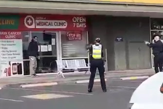 Police surround the armed man on Tuesday morning.