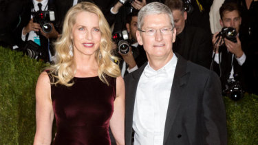 Apple chief Tim Cook with Laurene Powell Jobs.