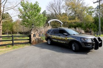A York County sheriff's deputy is parked outside the house where the shooting occurred.