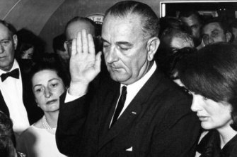 Lyndon B Johnson is sworn-in as 36th President of the United States, as Jackie Kennedy stands beside him, after the assassination of John F Kennedy.