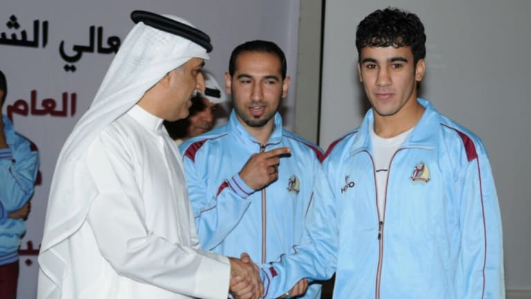 Hakeem al-Araibi (right) with AFC president Shiekh Salman, a member of the royal family who Araibi has been critical of in the past.