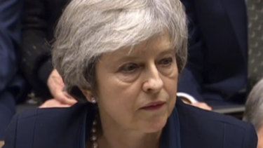 Britain's Prime Minister Theresa May speaks after losing a vote on her Brexit deal, in the House of Commons.