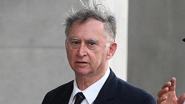 Former priest Michael Endicott arrives at the District Court in Brisbane.