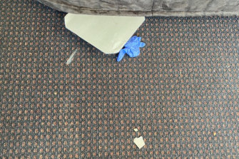 A children's toy, a rubber glove and other rubbish left in Hugh de Kretser's room at the Rydges on Swanston hotel by a previous guest.