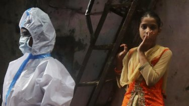 Health workers screen residents for COVID-19 symptoms at Dharavi, one of Asia's biggest slums, in Mumbai, India, Monday, Aug. 3, 2020. India is the third hardest-hit country by the pandemic in the world after the United States and Brazil. (AP Photo/Rafiq Maqbool)