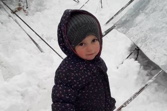 Fatema, 2, the daughter of Mariam Dabboussy and granddaughter of activist Kamalle Dabboussy, in the snow at al-Hawl camp this week.