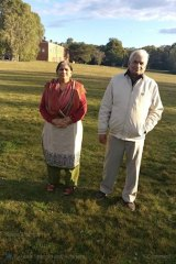 Mr Sharma's parents, pictured on a trip to Australia, are stuck at home in India with COVID-19, unable to access hospital care.