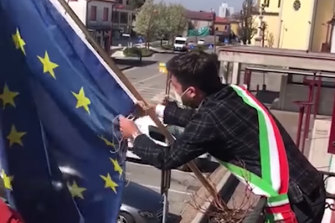 """Marco Schiesaro, the Lega mayor of Cadoneghe, filmed himself """"suspending"""" the flag of the European Union. The footage was tweeted out by Lega leader Matteo Salvini, who has urged the country to reconsider its relationship with Brussels following the crisis."""