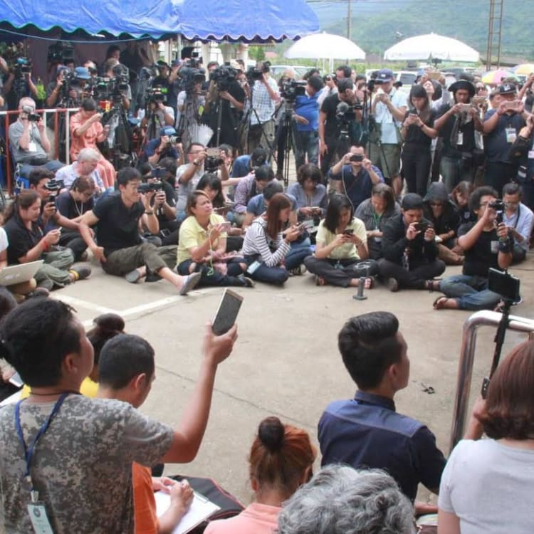 """The media pack at the press centre, once they were moved on from the earlier """"base camp""""."""