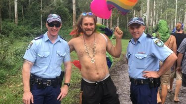 A reveller poses with NSW Police officers at a previous iteration of Bohemian Beatfreaks.