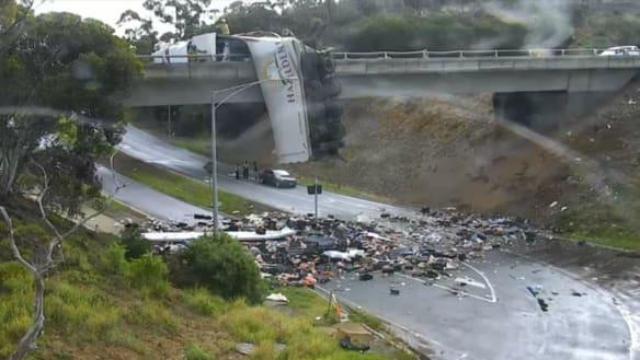 Truck left dangling on overpass shuts Calder Freeway