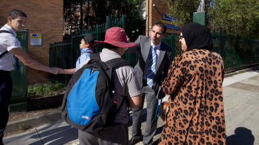 Jihad Dib and Mohamed Abdul-Jalil, co-vice captain, greet students at Punchbowl Boys\'.