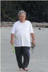 Peter Foster walking the beach in Port Douglas.