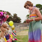 Rosie Batty visits the tributes left at the Tyabb oval after Luke's killing by his father Greg Anderson.