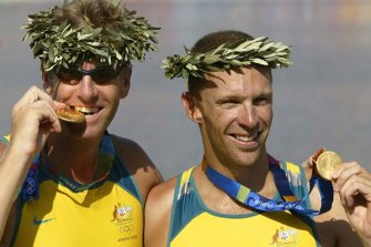 Drew Ginn, right, in a previous sporting life -  celebrating a gold medal with James Tomkin at the Athens Olympics in 2004.