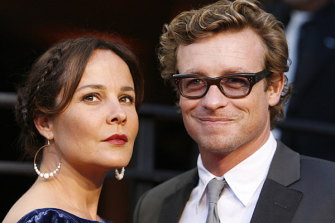 Actor Simon Baker and wife, actress Rebecca Rigg, arrive at the 2010 Vanity Fair Oscar party.