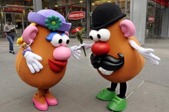 Mr. Potato Head (R) gives Mrs. Potato Head flowers outside of Hasbro's American International Toy Fair.