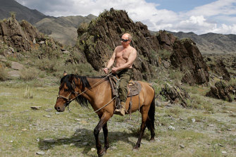 Russian Prime Minister Vladimir Putin rides a horse during his holiday outside the town of Kyzyl in Southern Siberia.