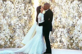 Kim Kardashian and Kanye West on their wedding day in 2014.
