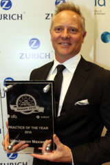 "Sam Henderson with his firm's award for ""Practice of the Year"""