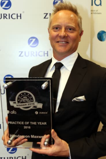 """Sam Henderson with his firm's award for """"Practice of the Year"""""""