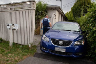 Armed police raid a Christchurch home after a person allegedly made a series of online posts threatening a terrorist attack on mosques involving car bombs on March 15.