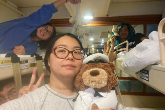 Teenager Kaitlyn Soh (left) with her mother Aun Na Tan and brother Xander in their cabin on the Diamond Princess.