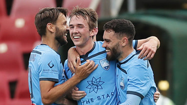 Calem Nieuwenhof celebrates his maiden A-League goal with Milos Ninkovic and Anthony Caceres.
