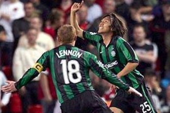 Striking: Celtic used a green and black strip during their Champions League campaign in 2006.