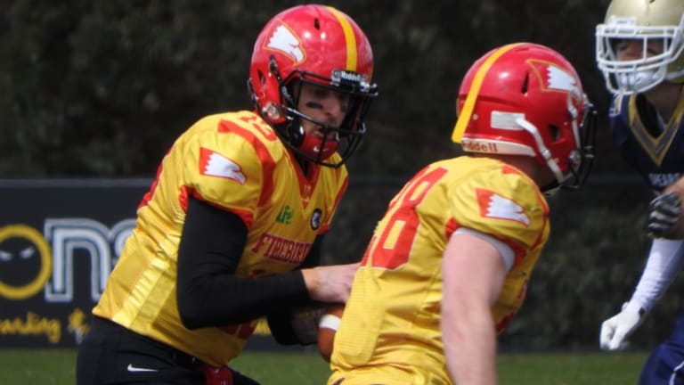 Firebirds quarterback Luke Job hands off to No.28 James Thornhill.