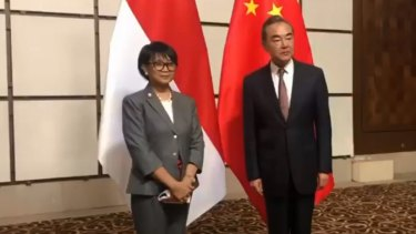 Indonesian Foreign Minister Retno Marsudi with her Chinese counterpart Wang Yi.