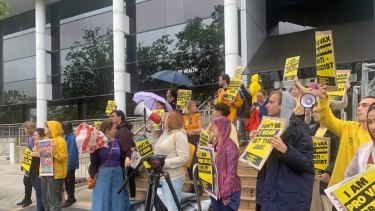 Pro-vaccine protestors at health HQ on Friday,