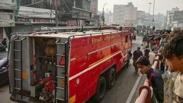 A fire truck attends a deadly blaze in downtown New Delhi.