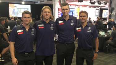 Freo coach Justin Longmuir with the club's draftees Caleb Serong (no.8), Hayden Young (no.7) and Liam Henry (no.9).