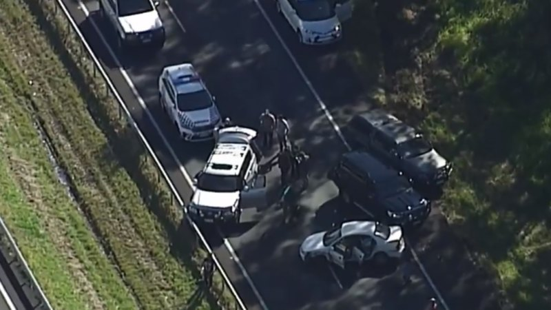 Armed car thief hit by car after Bruce Highway police chase