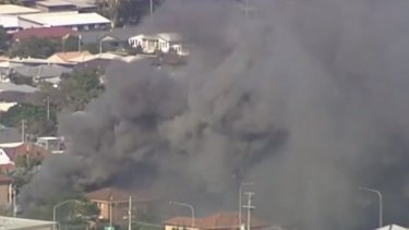 Smoke billows from the fatal house fire in Carina in Brisbane's east.