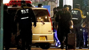A car is inspected by police after it injured several pedestrians on Takeshita Street in Tokyo, early on new year's day.