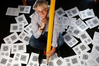 Crossword compiler David Astle has been puzzling readers for nearly 40 years.
