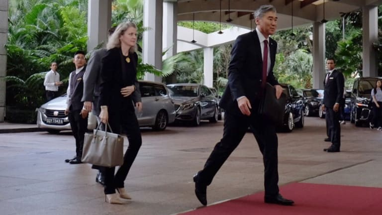 American ambassador to the Philippines, Sung Kim, arrives to meet the North Korean vice minister of foreign affairs, Choi Sun-hee.