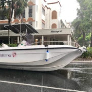 A boat slid off the back of its trailer and sat in a Port Douglas street on Tuesday.