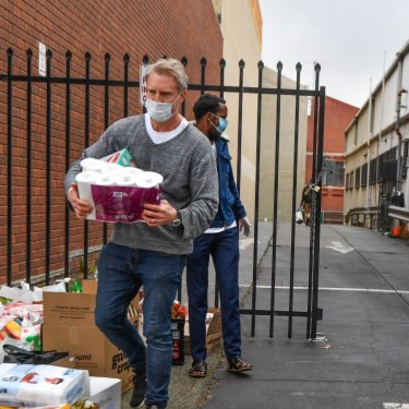 Deputy lord mayor Arron Wood helping collect donations at a North Melbourne mosque during the hard lockdown of high-rise housing towers in July.