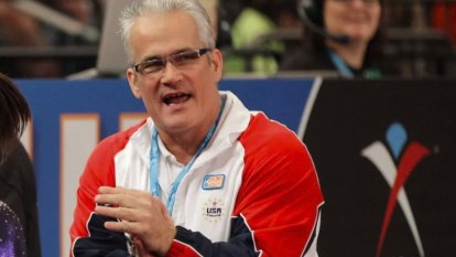 Ex-US Olympics gymnastics coach charged with human trafficking dies