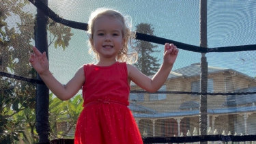 Luca McIlroy jumping on her trampoline before being diagnosed with a brain tumour.