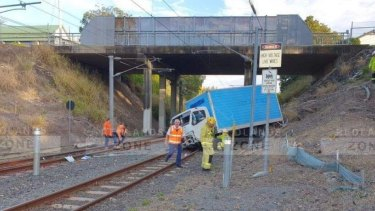 A truck has crashed onto railway tracks near Manly Station.